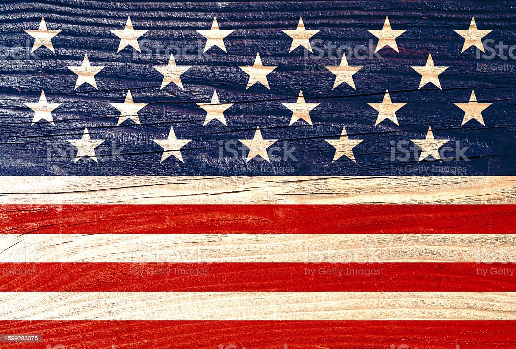 Stars and stripes on wood background stock photo