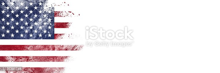 Abstract exploding powder in colors of US flag with lot of copy space on white background.