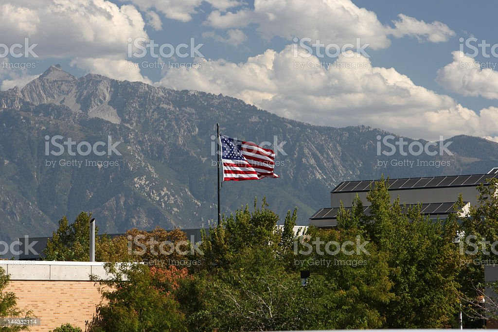 Stars and Stripes Set Against Salt Lake Mountains stock photo