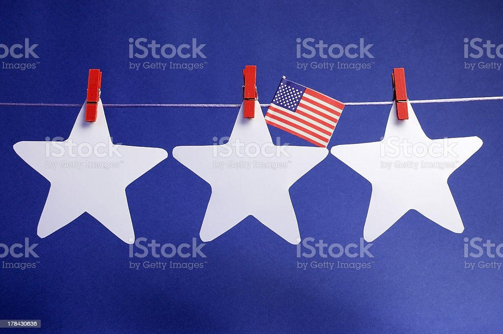 Stars and USA flag hanging from pegs on a line. royalty-free stock photo