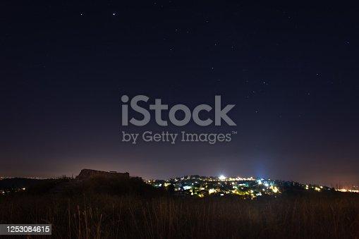 971578384 istock photo Stars at night 1253084615
