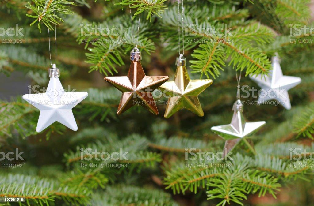 stars on a christmas tree, close-up stock photo