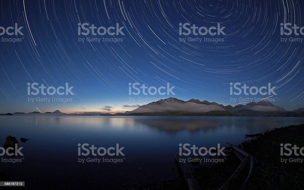 Stars over Kennedy Lake, Vancouver Island, Canada stock photo