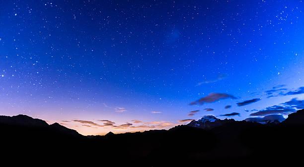 Stars over mountains stock photo