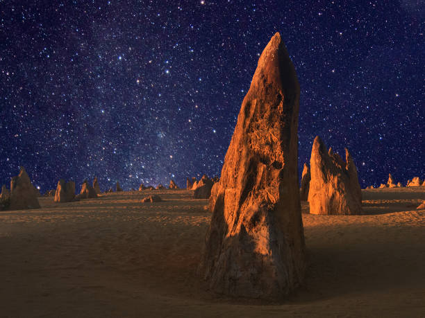 Stars over the landscape of the Pinnacle desert limestone formations at night stock photo