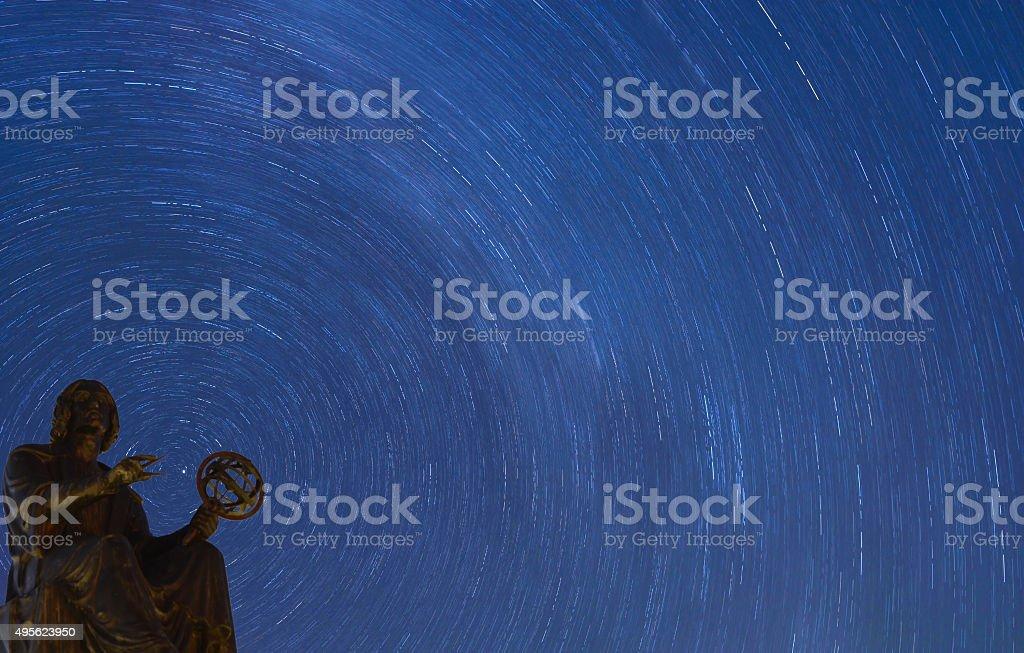 Stars rotating behind Copernicus monument, Chicago stock photo