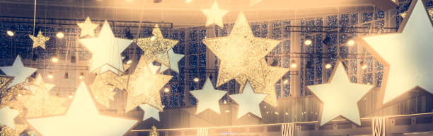stars shape show celebrity background  with spotlights soffits   vintage yellow golden colors as stage performance background - celebrities stock pictures, royalty-free photos & images