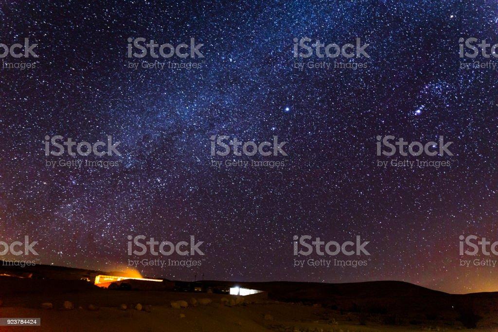 Stars sky night over camping tourist site, desert Israel. stock photo