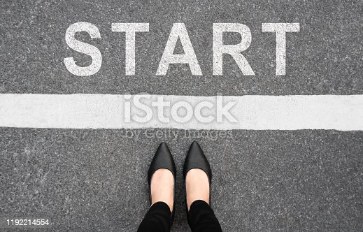 Start background, top view. Selfie of feet and legs in black high heels shoes on pathway. Businesswoman on starting line new beginning idea. Business challenge concept. Moving forward and future.