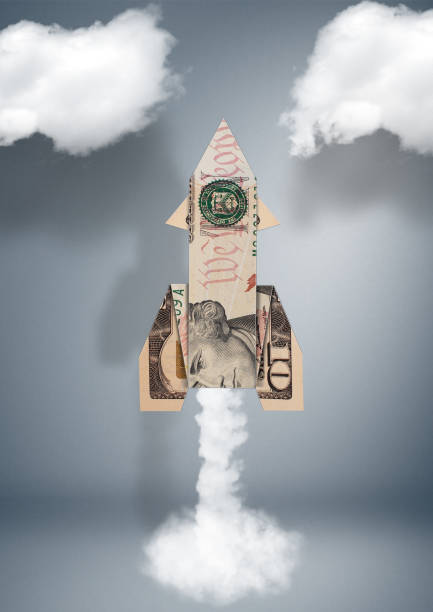 Start financial business concept, rocket made of money stock photo