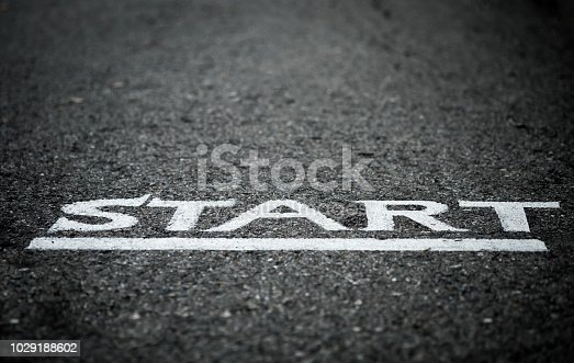 Close up of a start letters on the asphalt floor with vignette effect, concept photo of the starting point for doing something.