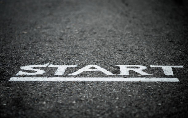 Start letters on asphalt floor with vignette mood and toon, selective focus. Close up of a start letters on the asphalt floor with vignette effect, concept photo of the starting point for doing something. starting line stock pictures, royalty-free photos & images