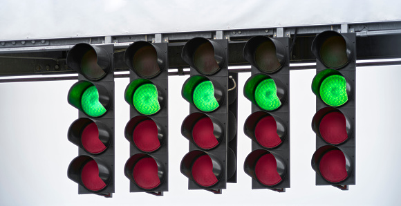 Close-up of green start lights in racing circuit.