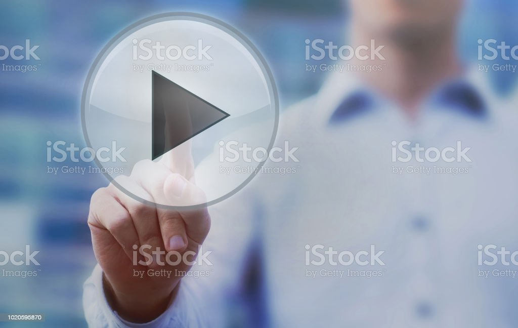 start new project, hand pushing play button stock photo