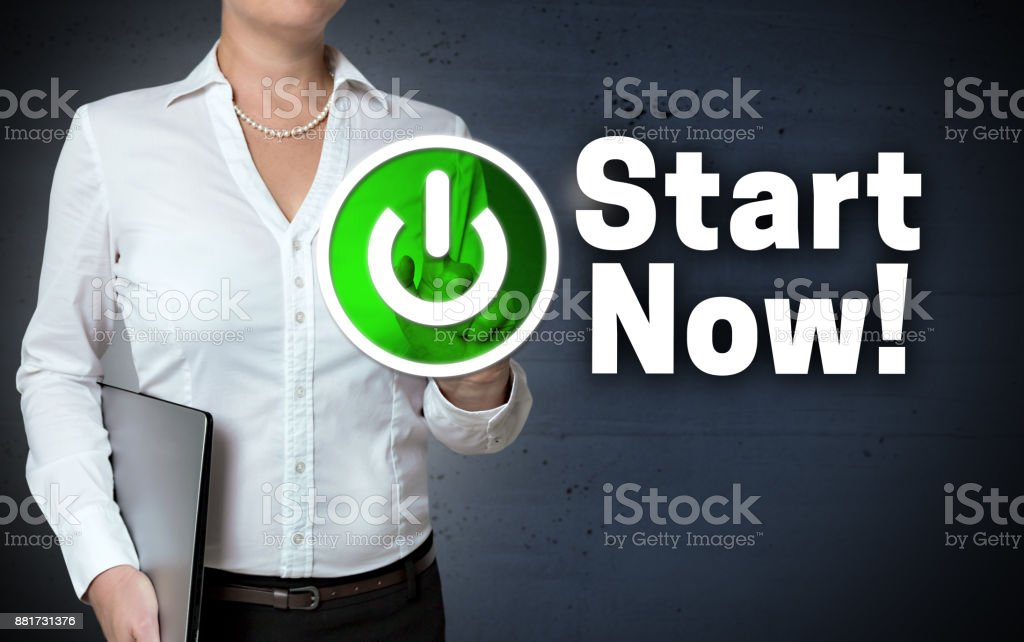 Start Now concept touchscreen is shown by businesswoman stock photo