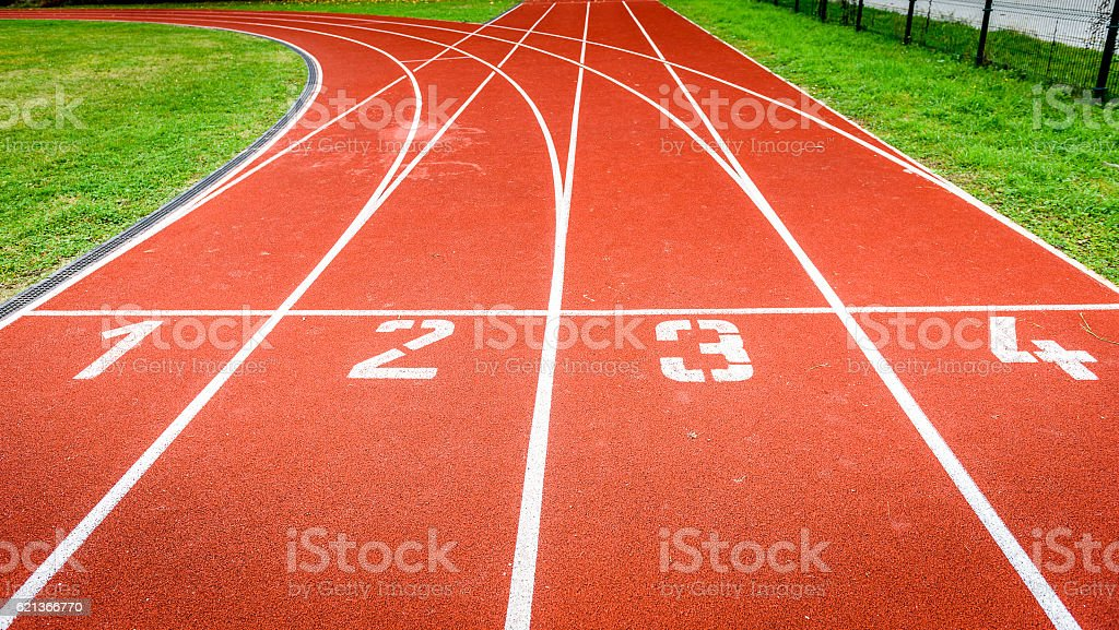 Start numbers on athletic running track in stadium. stock photo