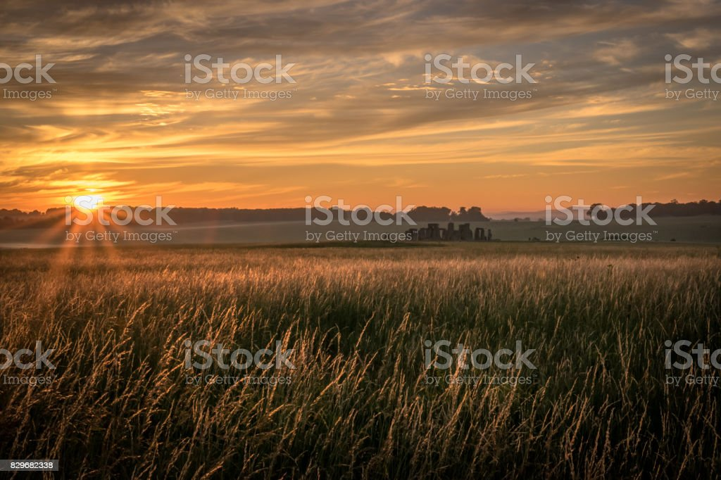 Start of a new day Sunrise at Stonehenge stock photo
