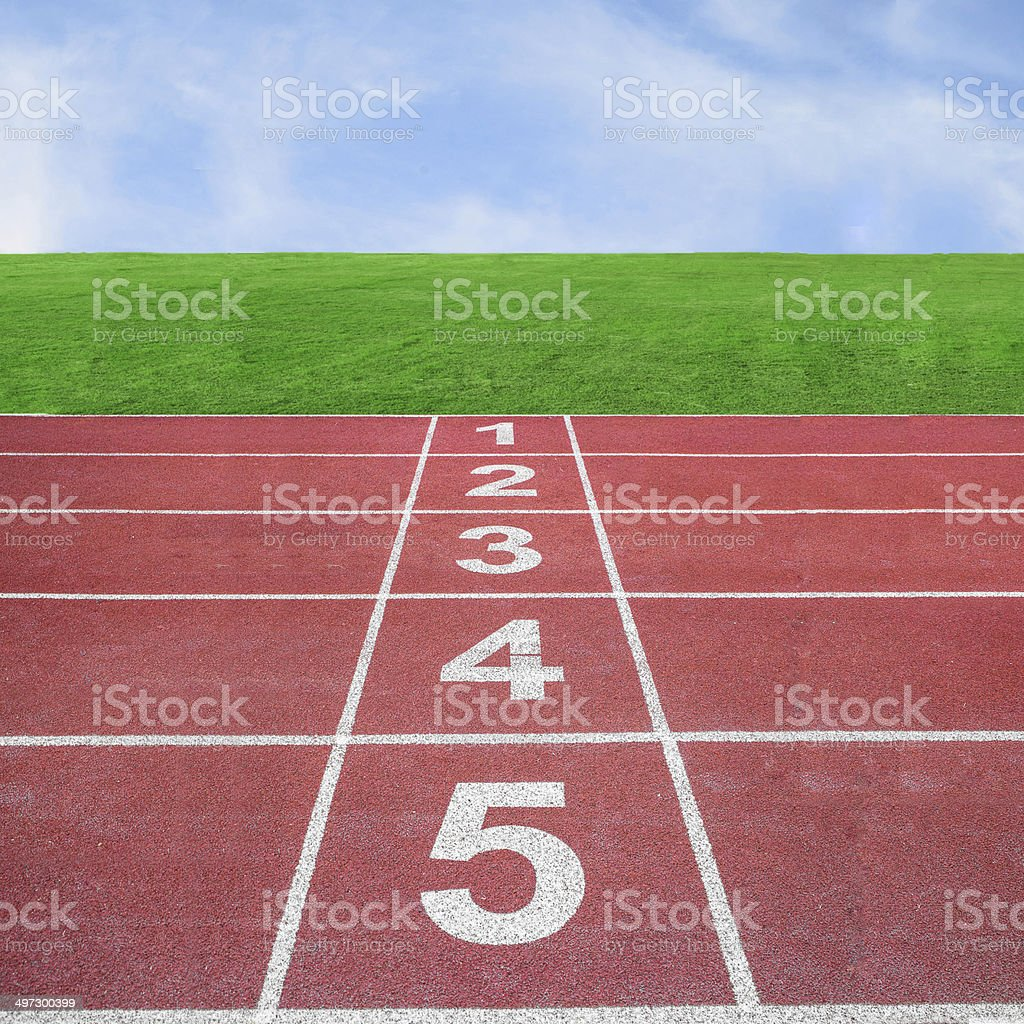 Start or finish position on running track with blue sky stock photo