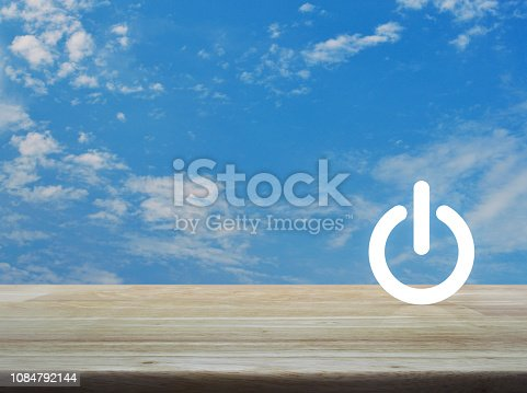 Power button flat icon over blue sky with white clouds, Start up business concept