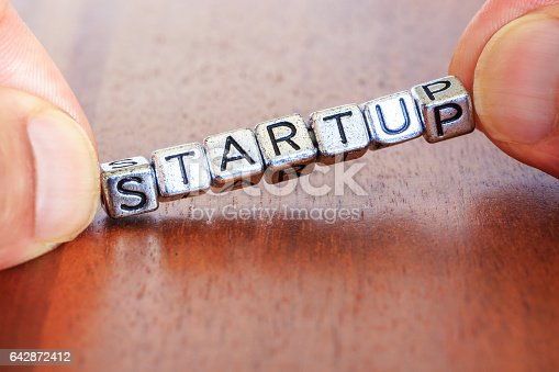 istock Start up business finance concept with metal letters 642872412