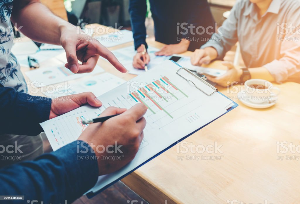 Start up business team colleagues meeting Planning Strategy Analysis discussing new plan financial on graph data new business project - foto stock
