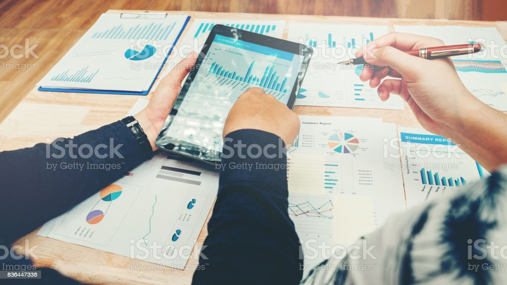 Start up business team meeting working on digital tablet new business project stock photo