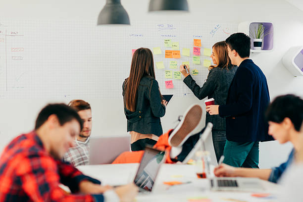start up community at work. - web designer stock photos and pictures