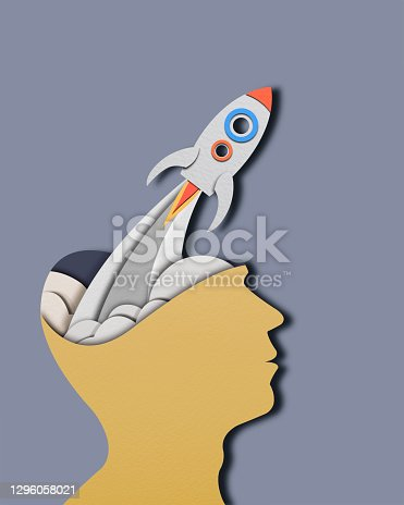 Start Up Business Concept With Space Rocket. Paper Cut  Space rocket and Human Head on Blue Background. For create letter or symbol, business, banner, advertising concept, banner size with copy space