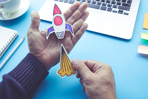 Start Up Concepts With Rocket In Male Hand Stock Photo - Download Image Now