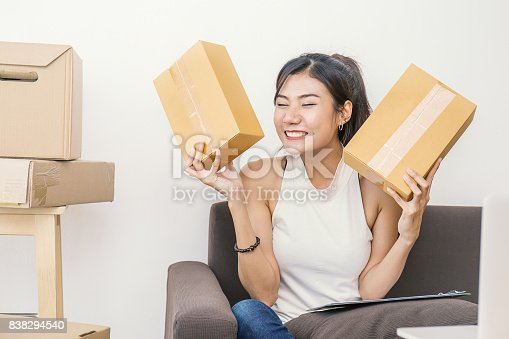 istock Start up small business entrepreneur or freelance woman holding boxes working at home concept, Young Asian small business owner at home office, on line marketing packaging and delivery 838294540