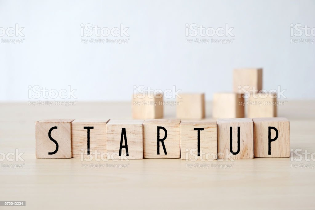 Start up word on wooden cubes background, business concept royalty-free stock photo