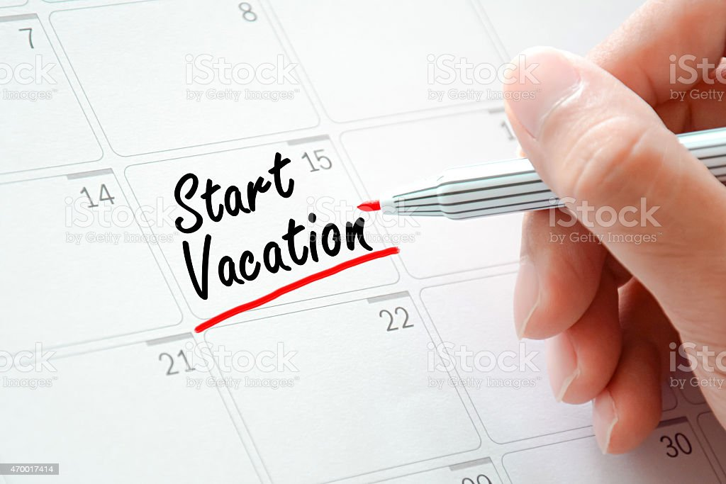 Start Vocation text on the calendar (or desk planner) stock photo