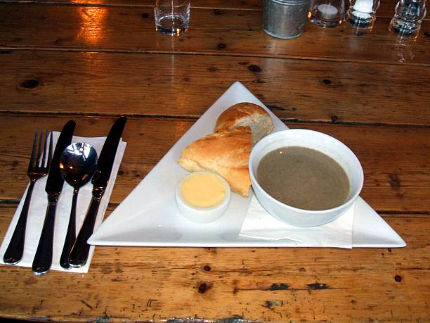 Starter.Appetiser.Mushroom soup,butter & bread stock photo