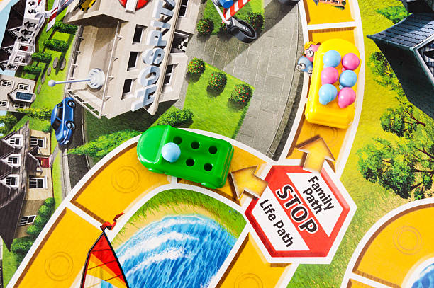 starting a family in the game of life - game of life stock photos and pictures