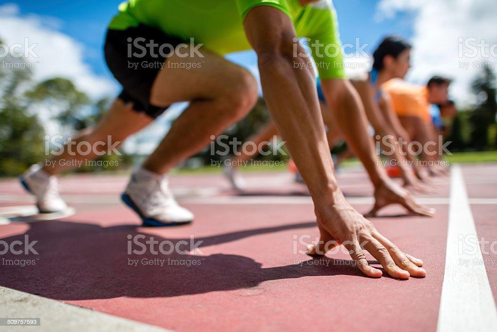 Starting block og athletes stock photo