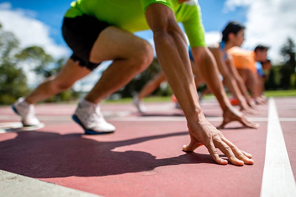 Starting block og athletes Starting block of athletes ready for  starting line stock pictures, royalty-free photos & images