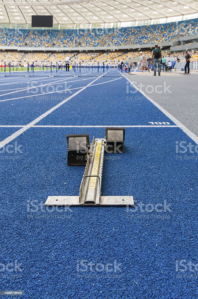 starting block on the track stock photo