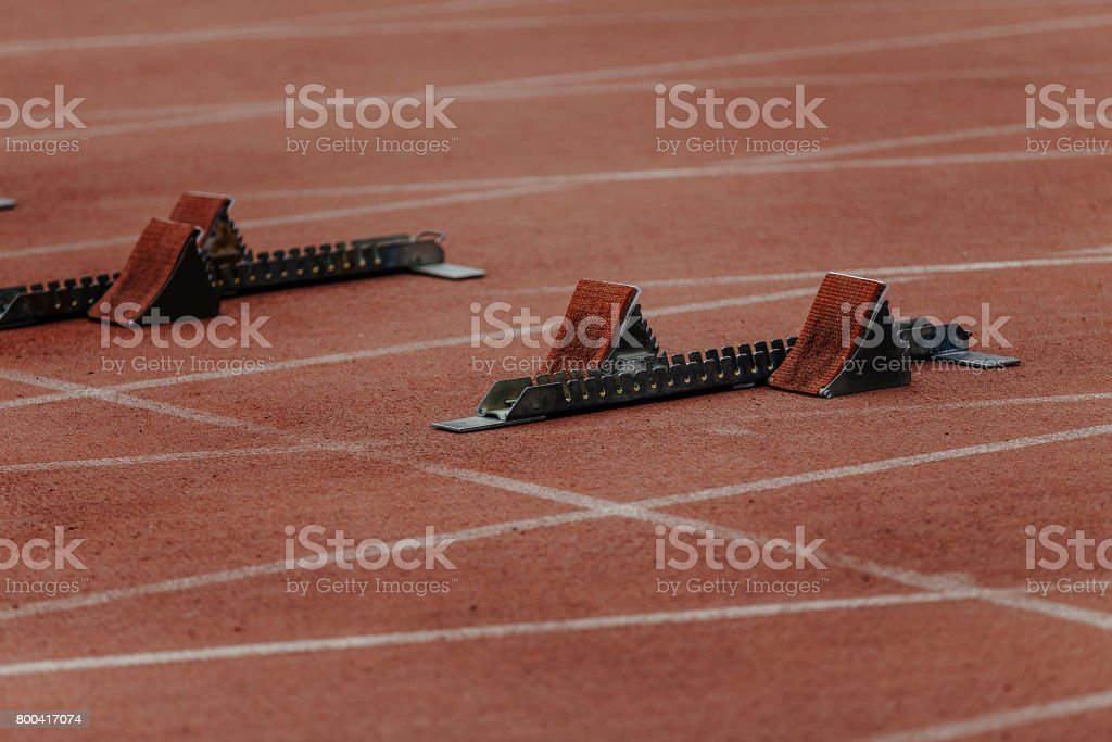starting blocks on start line of sprint 100 meters stock photo
