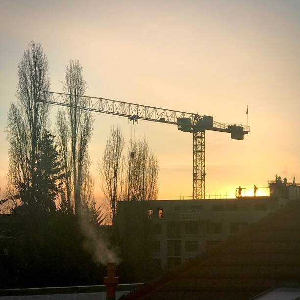 Starting building work at dawn as the sun rises. stock photo