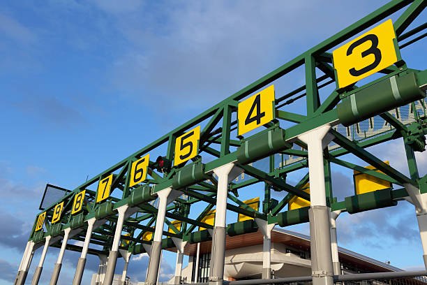 starting gate that has number in yellow boards - racehorse track bildbanksfoton och bilder