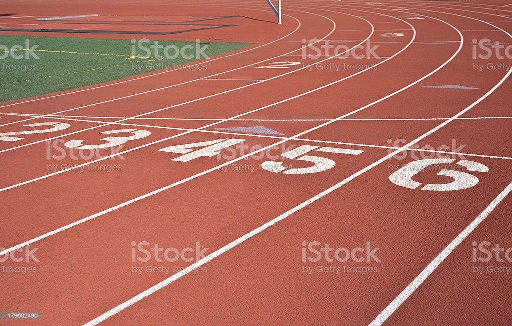 Starting line on red running track stock photo