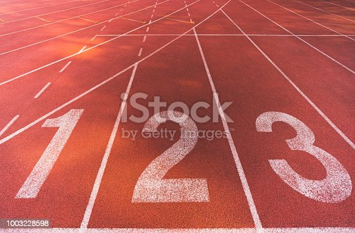 istock Starting line position of running track background texture, lane number 1, 2, 3. Business competition conceptual, or athletic racing sport concept 1003228598