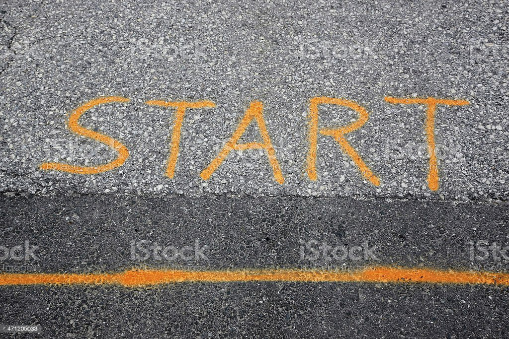 Starting line with text 'START' as painted on asphalt road royalty-free stock photo