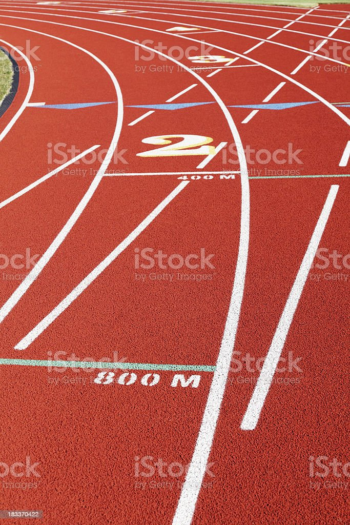 Starting Lines at Curve on Red Running Track stock photo
