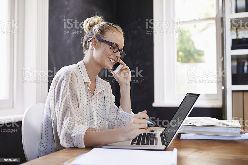 Starting out her business from home stock photo