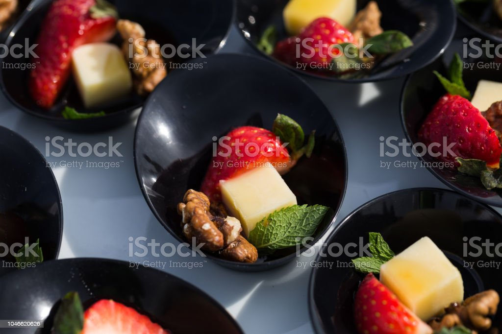 Starting party snack: cheese strawberry nut mint stock photo