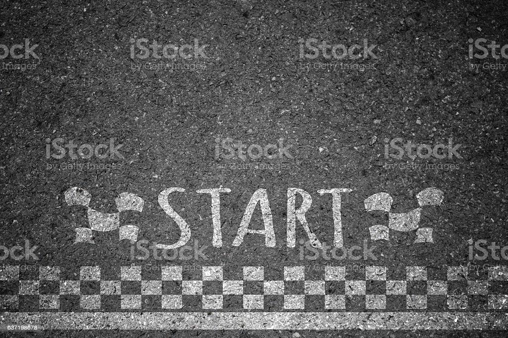 Starting point line asphalt formula background. stock photo