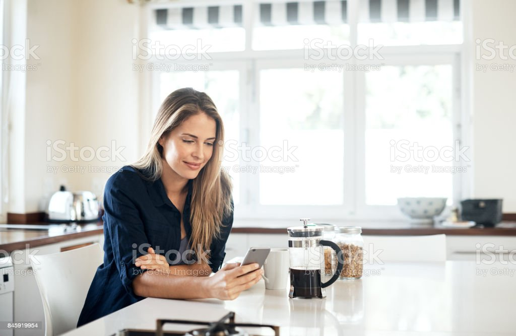Starting the day with a scroll through the social network stock photo