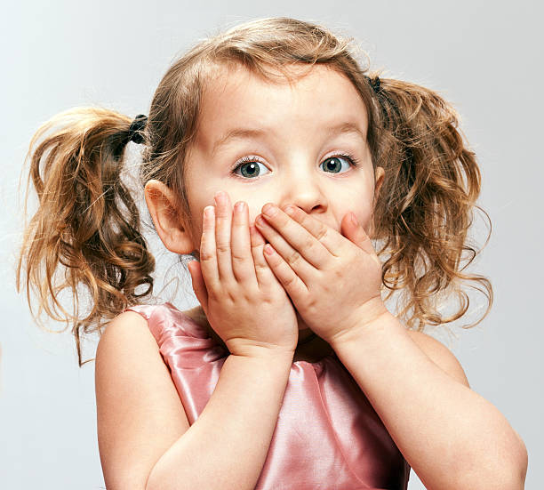 startled little girl - pigtails stock photos and pictures