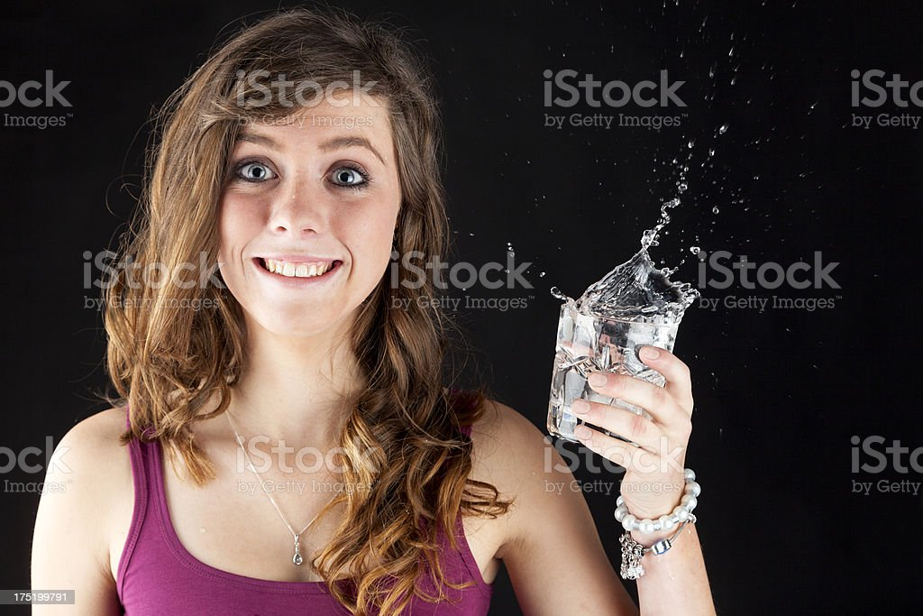 Startled Teen With A Splashing Drink royalty-free stock photo